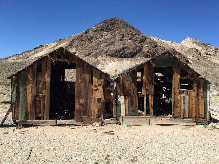 Abandoned built structure against rocky landscape