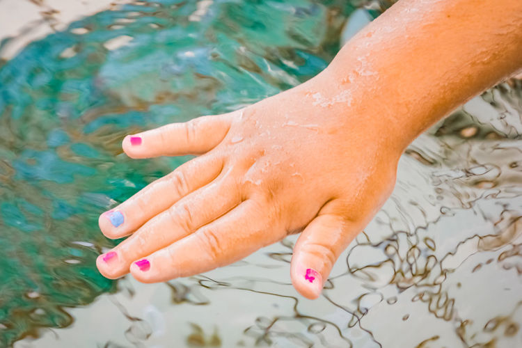 close up of little girl's hand showing chipped nail polish Human Body Part Human Hand Water Hand One Person Body Part Real People Finger Human Finger Nail Nail Polish Lifestyles Leisure Activity Nature Close-up Wet Outdoors Swimming Pool Females Girls Childhood Child