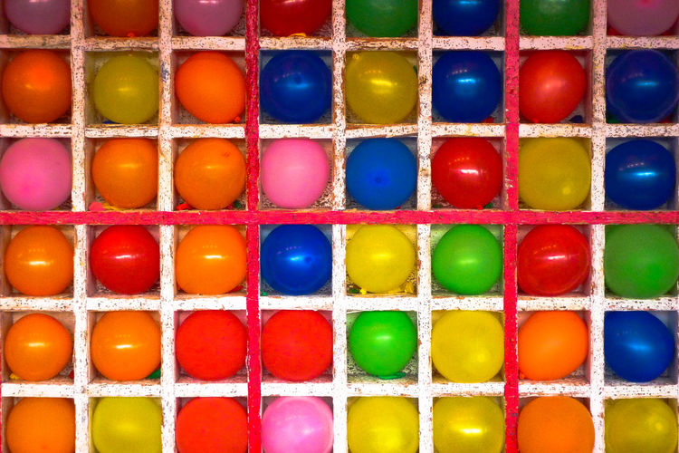Ballons Fair Carnival Game Grid Square Squares Winning Pop Pop Culture Colors Life Colours Colour Colour Red Yellow Green Blue Orange Lines Geometric Shape Tictactoe No People Multi Colored Choice In A Row Side By Side Backgrounds Close-up