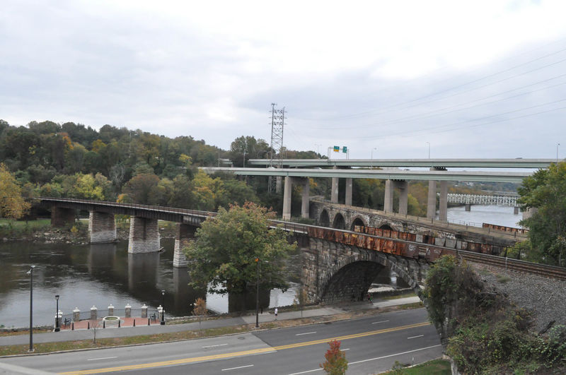 Bridge and Roadway in Philadelphia Pennsylvania Pennsylvania Philadelphia Architecture Bridge - Man Made Structure Built Structure City Connection Land Vehicle Mode Of Transport Nature No People Outdoors Public Transportation Rail Transportation Road Train - Vehicle Transportation Urban Landscape Water