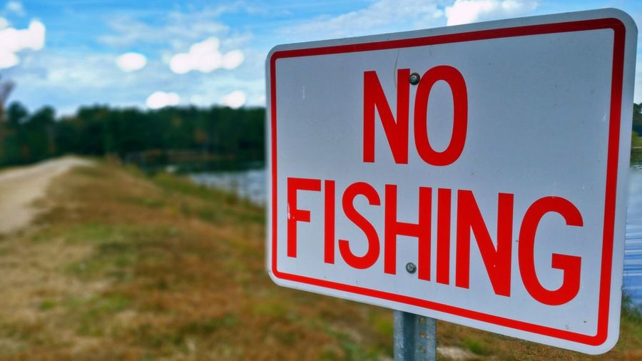 No Fishing (in HDR) -- happy Sunday! ✌ Hdr_Collection Hdr Edit Macro Selective Focus Focus On Foreground Sign Signs Bokeh Red Text Sky Cloud - Sky Clouds And Sky Close-up Warning Sign No People Outdoors Day Communication Autumn Water Landscape Tranquility No Fishing
