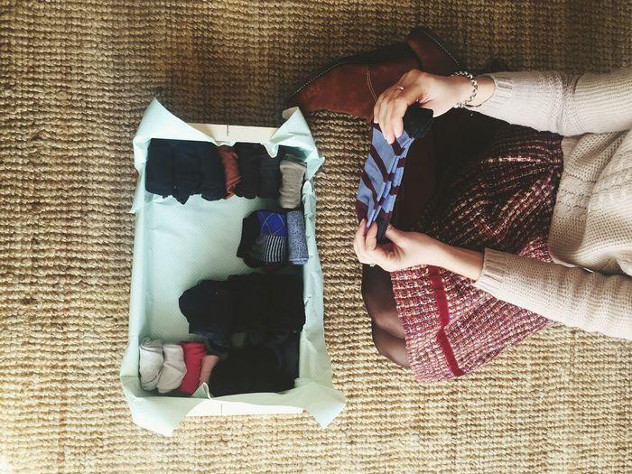 High angle view of woman folding socks