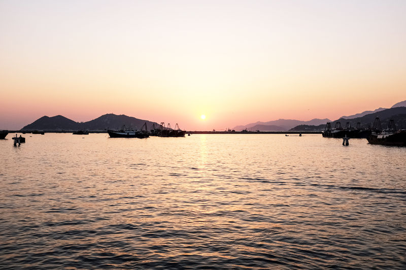 Hong Kong Sunset Architecture Beauty In Nature Clear Sky Copy Space Idyllic Mountain Nature No People Non-urban Scene Orange Color Outdoors Scenics - Nature Sea Sky Sunset Tranquil Scene Tranquility Water Waterfront