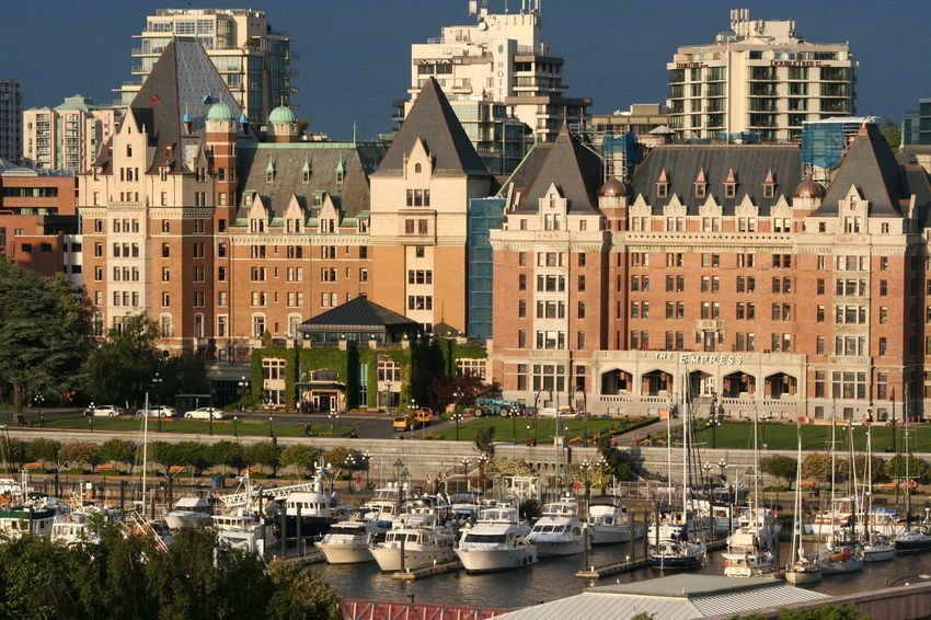 Architecture Blue Building Building Exterior Built Structure City City Life Day Grass Green Color Growth Lawn Modern No People Outdoors Side By Side Sky The Empress The Fairmont Empress Hotel Tourism Travel Destinations Tree Victoria Harbour Adapted To The City The Architect - 2017 EyeEm Awards