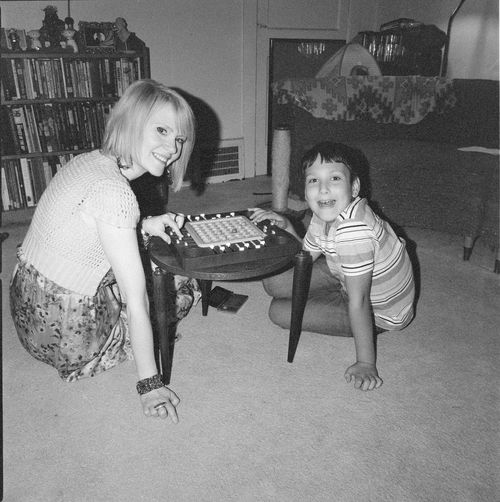 """Something a little different with my son and his """"Bonus Mom"""". Children Family Games Kinder Bonding Childhood Childhood Memories Family Time Friendship Happiness Indoors  Kid Lifestyles Living Room Looking At Camera Monochrome Photography People Playing Portrait Real People Sitting Smiling Togetherness Two People"""