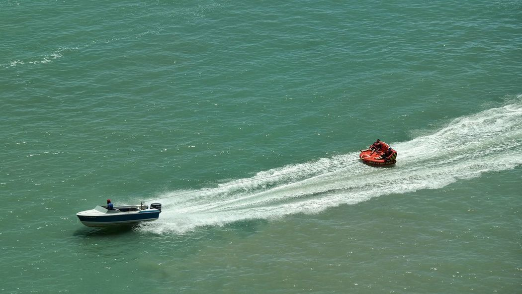 Adventure Club Tubing Time Bouncing On Waves Fun On The Water Splashing Exhilirating Waves Inflated Hanging On Colours Water Sports Towing The Dinghy Sea Sports Inflatables Inflatable  High Up Tubing Boats Speedboat Water Splash Towed Happiness Sea Wake Fun