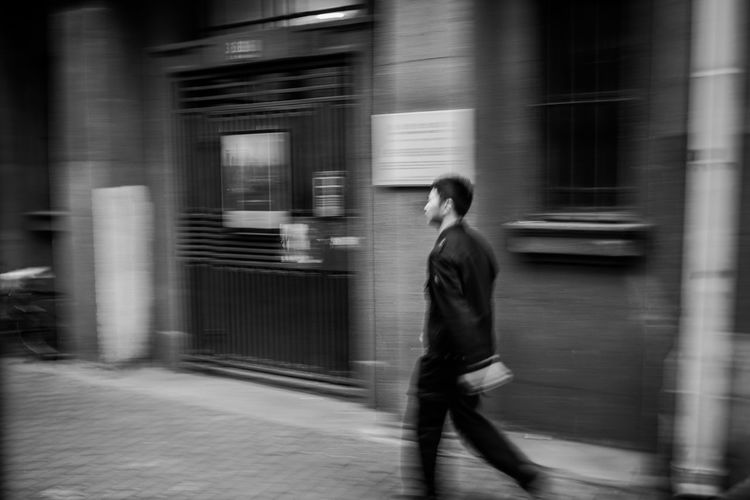 Black And White Street Photography, China Photos Shanghai Streets Shanghai, China Adult Architecture Blackandwhite Photography Blurred Motion Building Exterior Busy City City Life Motion on the move One Person Outdoors Shanghai Street Photography Shanghailife Side View Speed Street Street Photography Street Photography China Urgency Walking The Street Photographer - 2018 EyeEm Awards