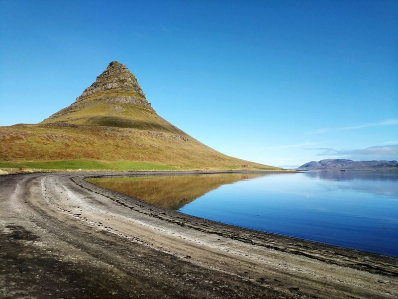 West Iceland Snaefellsnes Peninsula Kirkjufell Kirkjufell Mountain Icelandic Landscape Prominent Landmark Water Clear Sky Mountain Lake Triangle Shape Sunny Ancient Sky Landscape Pyramid Shape Natural Landmark Countryside Physical Geography