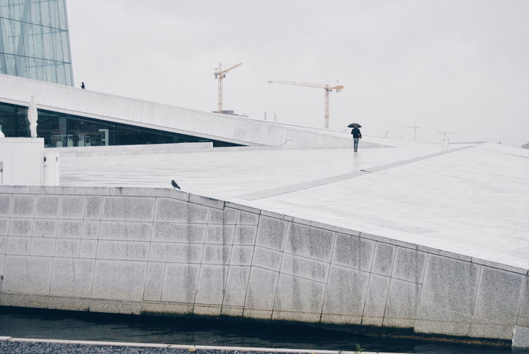 People Walking On Walkway At Oslo Opera House