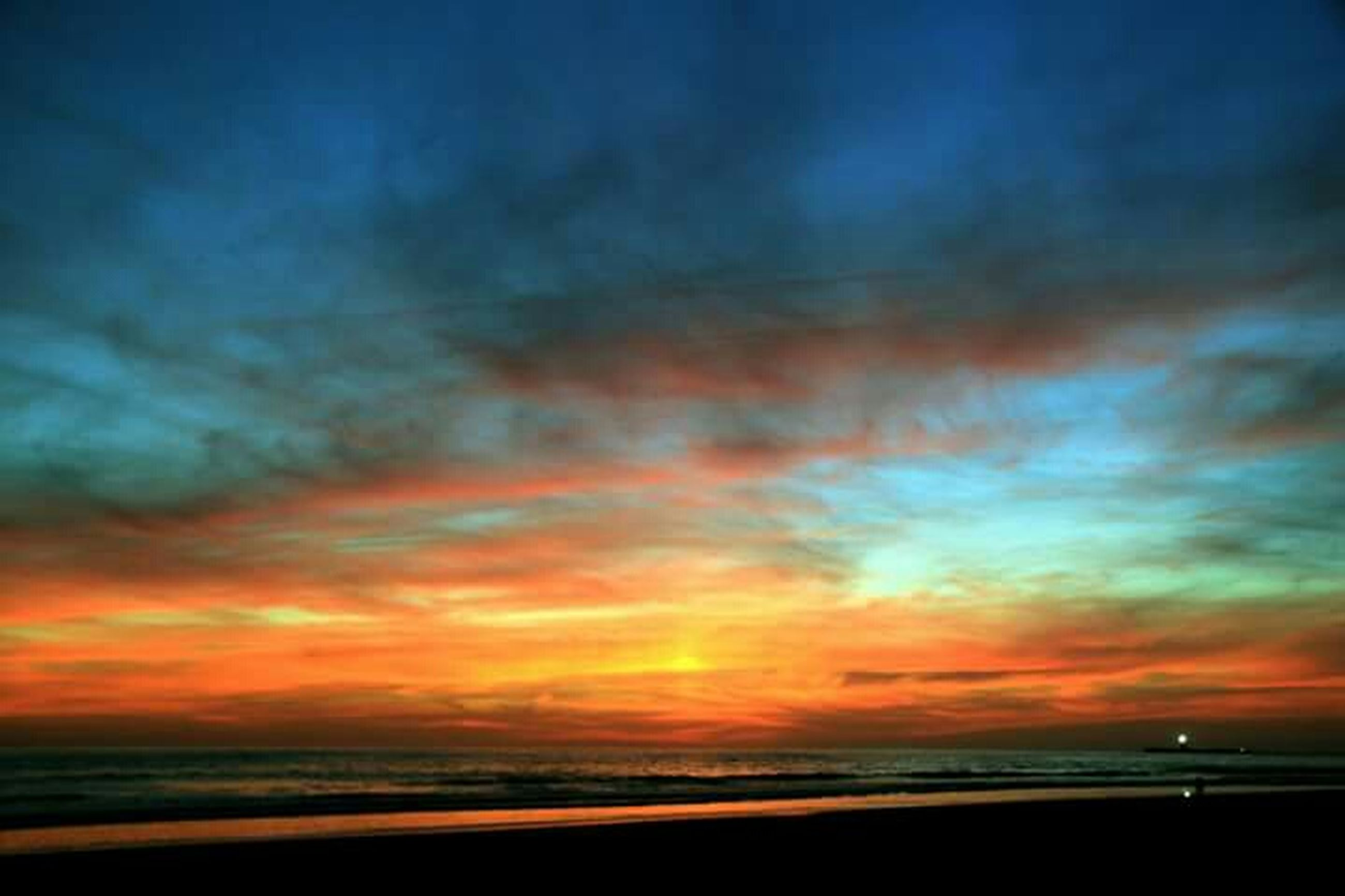 sea, horizon over water, beach, sunset, scenics, water, tranquil scene, beauty in nature, sky, tranquility, shore, idyllic, cloud - sky, nature, orange color, dramatic sky, cloud, sand, cloudy, dusk