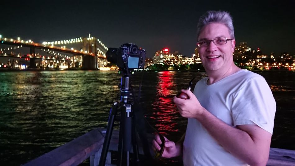 New York Brooklyn Brooklyn Bridge / New York Manhattan New York New York City Adult Architecture Emotion Glasses Happiness Holding Illuminated Looking At Camera Mature Adult Mature Men Nature Night One Person Portrait Smiling Standing Transportation Waist Up Water