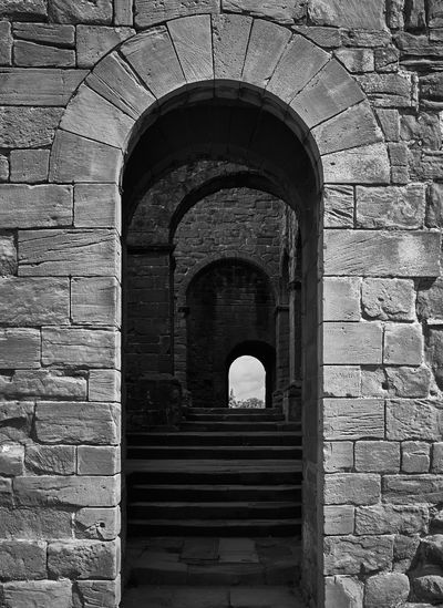Archways to archways . British Culture Architecture Built Structure Arch Wall No People Brick Day Old Building Exterior Brick Wall History Wall - Building Feature The Past Direction Building The Way Forward Stone Wall Outdoors Travel Destinations Entrance Arched Architecture Architecture_collection Archway Archways Black And White Black And White Photography Black And White Collection  Stone Material Castle Castle Ruin