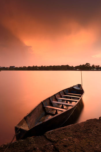 Red Sunset Sunset Water Sky Nautical Vessel Tranquil Scene Beauty In Nature Tranquility Scenics - Nature Orange Color Mode Of Transportation Moored Transportation Reflection Nature No People Idyllic Non-urban Scene Lake Cloud - Sky Outdoors Rowboat Red Dramatic Sky Boat Tropical Climate Rainy Days Cloudy INDONESIA Indonesia_photography Landscape Scenics Nature