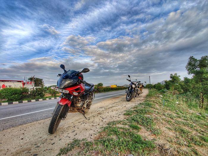 Motorcycle on road against sky