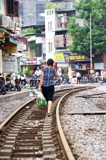 Hanoi Hanoi Vietnam  Hanoi, Vietnam Hanoi City Vietnam Vietnamese Vietnamesegirl Vietnamphotography Vietnam Trip Streetphotography Train Tracks Walking Around Walking On Train Tracks