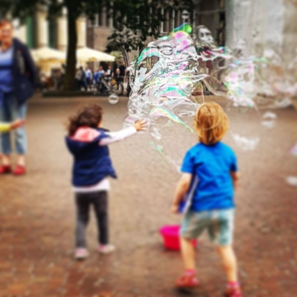 Seifenblasen Bremen La Strada Bubble Wand Child Childhood Full Length Multi Colored Girls Boys Fun Warm Clothing Playing The Street Photographer - 2018 EyeEm Awards