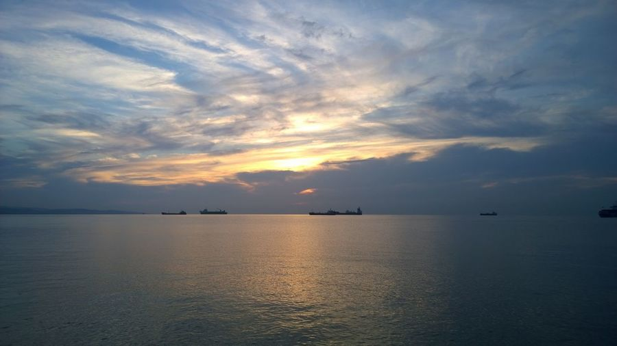 Sky Cloud - Sky Water Scenics - Nature Sea Waterfront Beauty In Nature Sunset Tranquility Tranquil Scene Horizon Horizon Over Water No People Idyllic Nature Nautical Vessel Reflection Transportation Non-urban Scene
