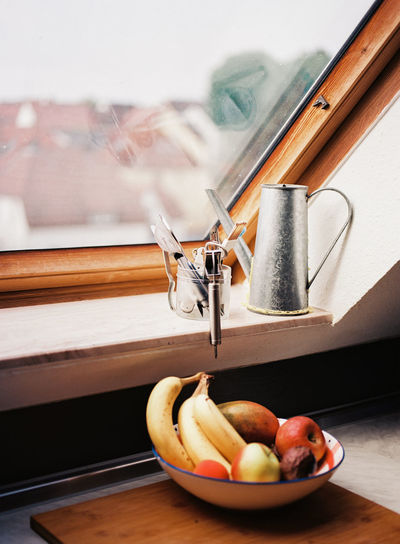 This was taken on 120 Ektar film. Shot in early morning from our AirBnB in Stuttgart, Germany. Eat Healthy Morning Morning Light Apple - Fruit Banana Day Film Photography Food Freshness Fruit Germany Glass - Material Health Healthy Eating Indoors  No People Serene Still Life Table Wellbeing Window