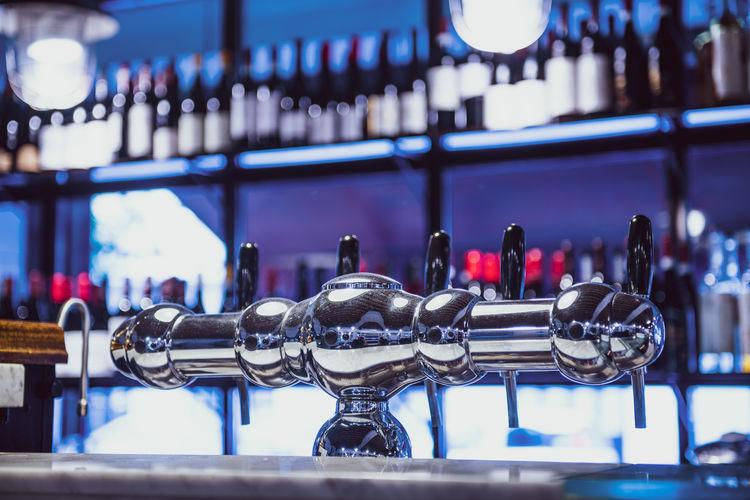 Close-up of beer tap at bar