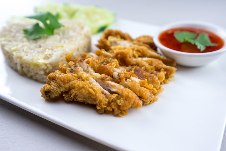 Fried Chicken Rice Chicken Dinner Food And Drink Food Plate Freshness Fried Chicken Garlic Isolated Meal Thai Thailand Background Chicken Organic Closeup Delicious Food Food Decoration Foodphotography Fresh Fried Chicken Rice Organic Restaurant Sauce Street Food Thai Food