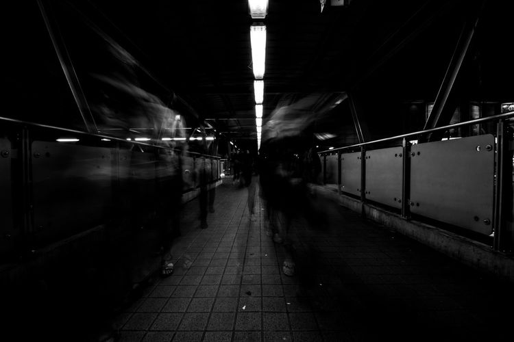 Architecture Blurred Motion Ceiling City Diminishing Perspective Direction Group Of People Illuminated Incidental People Men Mode Of Transportation Motion Night Outdoors Platform Public Transportation Rail Transportation Railroad Station Railroad Station Platform Real People Station Train Transportation Travel Walking EyeEmNewHere