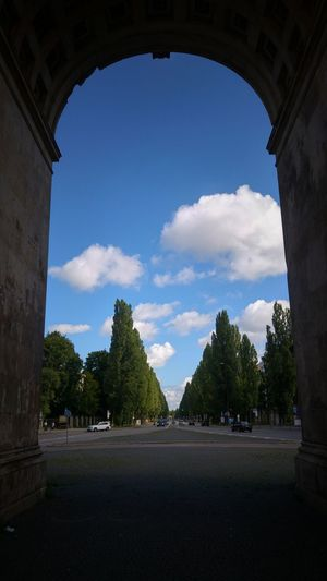 Cloud - Sky Travel Destinations Arch Sky Architecture Tree Day No People Outdoors Gateway Arch Munich, Germany Main Street Tree Rows Last Days Of Summer