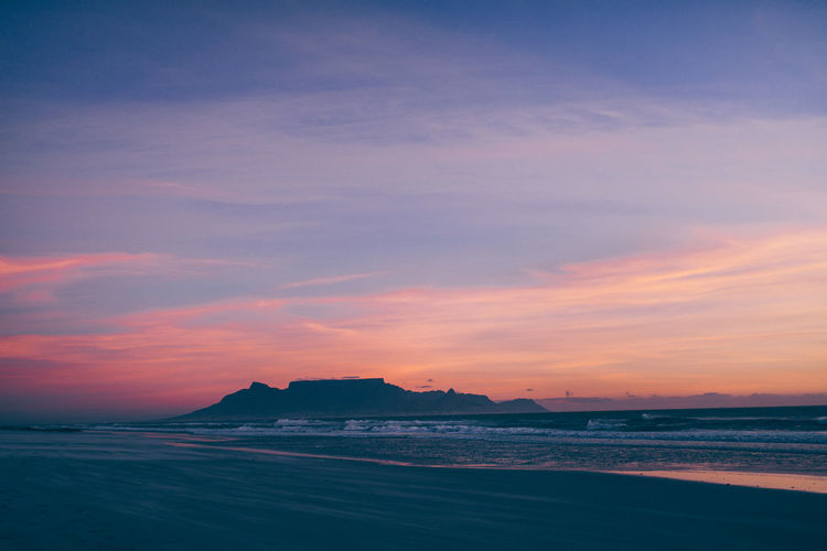 Sky Water Sea Sunset Scenics - Nature Beauty In Nature Tranquility Tranquil Scene Cloud - Sky Nature Beach Land Idyllic No People Orange Color Waterfront Dusk Outdoors Silhouette Cape Town Table Mountain