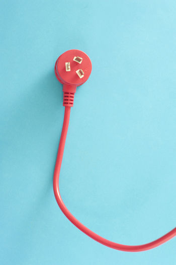Close-up of red light against blue background