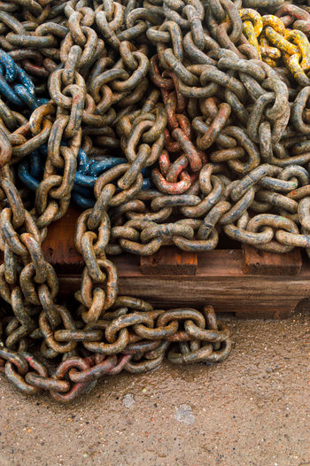 High angle view of rope tied on rusty metal