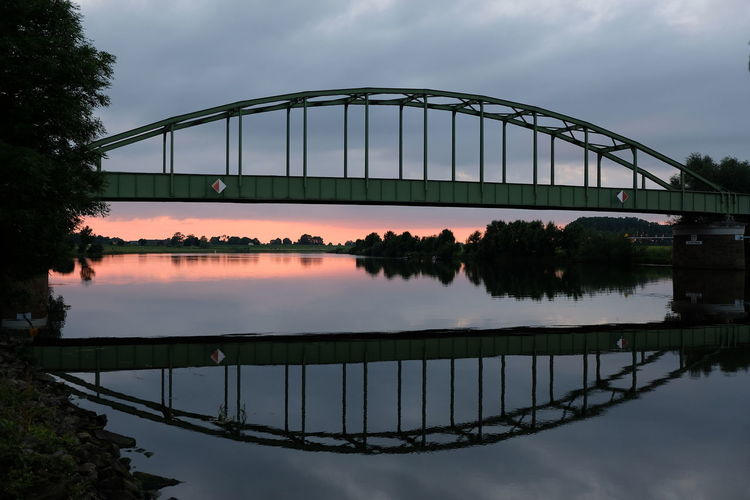 Architecture Bridge Bridge - Man Made Structure Bridge Reflections Built Structure Cloud - Sky Elbe Elbe River Germany Germany Photos Official EyeEm © Nature Old Bridge Old Bridges Reflection River Sky Steel Bridge Sunset Sunset Reflection Sunset_collection Suspension Bridge Transportation Transportation Water Water Reflections Connected By Travel