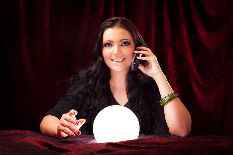 Psychic reading your future Crystal Ball Fortune Telling Witchcraft  Brunette Charlatan Clairvoyance Forecast Fortune Teller Future Indoors  Magic Magick Medium One Person People Phone Psychic Psychic Medium Witch Women Young Adult