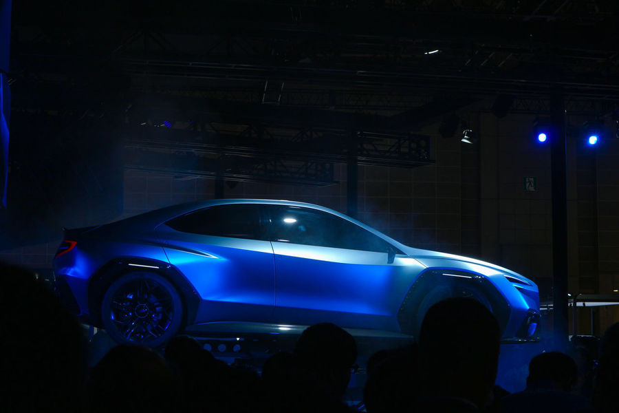 modern car showing with blue light in the dark Japan Tokyo Blue Bluelight Car City Crowd Day Illuminated Land Vehicle Lifestyles Luxury Mode Of Transportation Motor Vehicle Motorshow Nightlife Perfomance Showing Space Technology Transportation