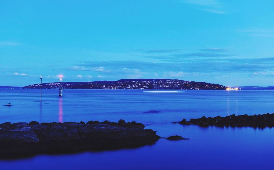 Nesodden seen from Bygdøy #bluehour #sea #fjord #rx100v #Oslo #akershus Water Sea Sky Scenics - Nature Blue Beauty In Nature Tranquil Scene Outdoors Cloud - Sky Beach Idyllic Land