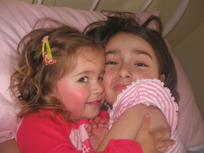 Bedtime Hug Sisters Bed Child Childhood Close-up Cuddles Cute Girls Happiness Indoors  Innocence Lifestyles Love People Real People Rosie Cheeks Sibling Smiling Togetherness Two People