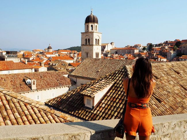 Looking over Dubrovnik old town Wanderlust Travel Photography Travel Destinations Travel Europe Croatia Old Town Dubrovnik, Croatia Dubrovnik Architecture Built Structure Building Exterior Rear View Religion Real People Clear Sky History Day Outdoors Travel Destinations Roof One Person Standing Women Full Length Lifestyles