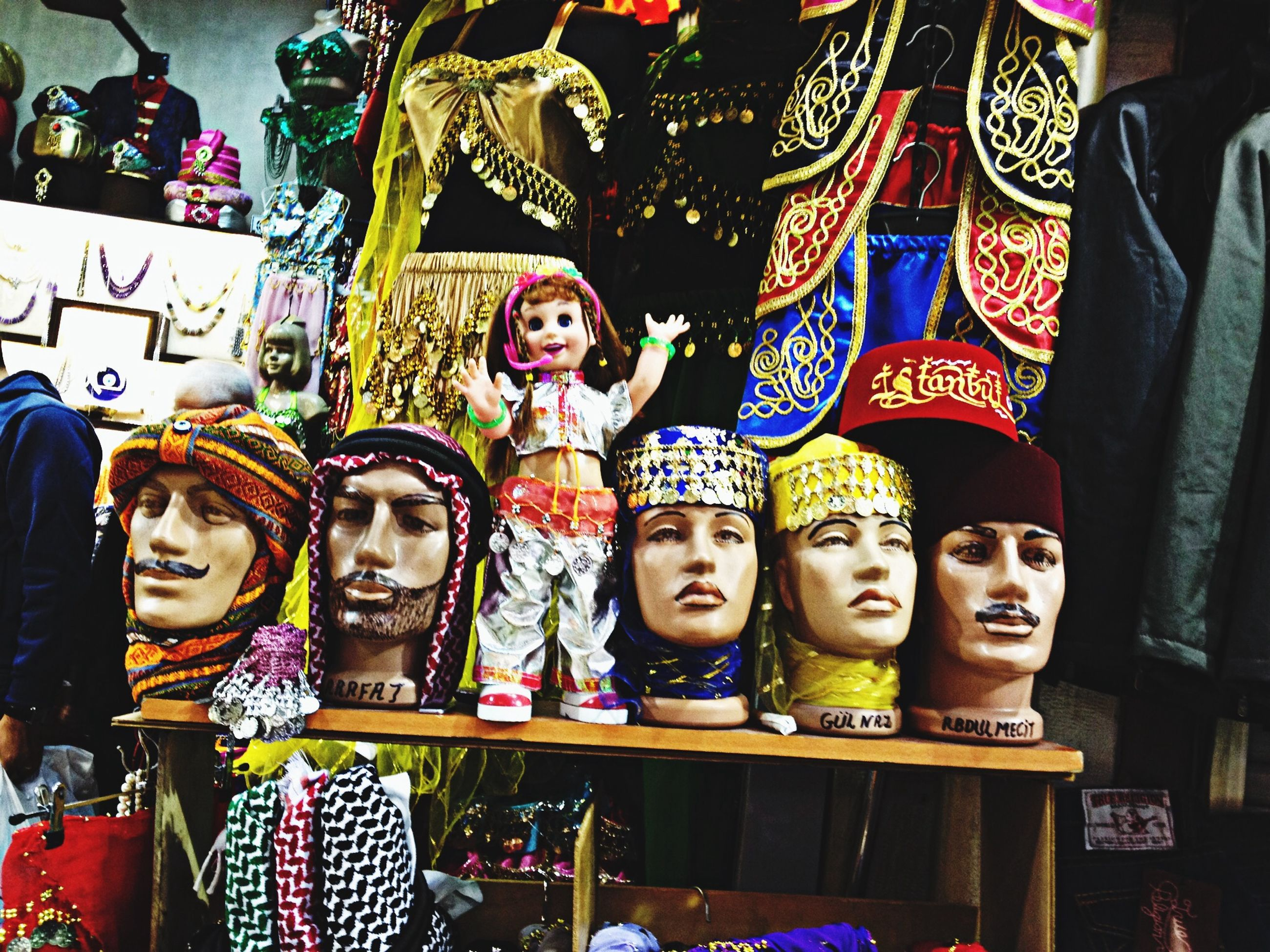 human representation, indoors, art and craft, art, creativity, multi colored, retail, for sale, store, large group of objects, shop, statue, display, variation, market, choice, front view, sale