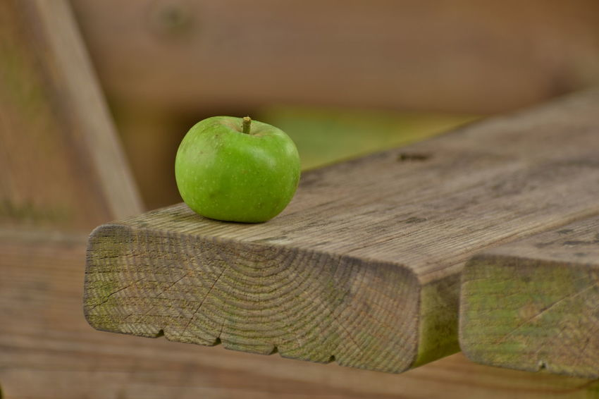 Apple in Calvados Apple Apple - Fruit Close-up Cutting Board Day Focus On Foreground Food Food And Drink Freshness Fruit Green Color Healthy Eating No People Outdoors Ripe Selective Focus Still Life Table Two Objects Wellbeing Wood - Material