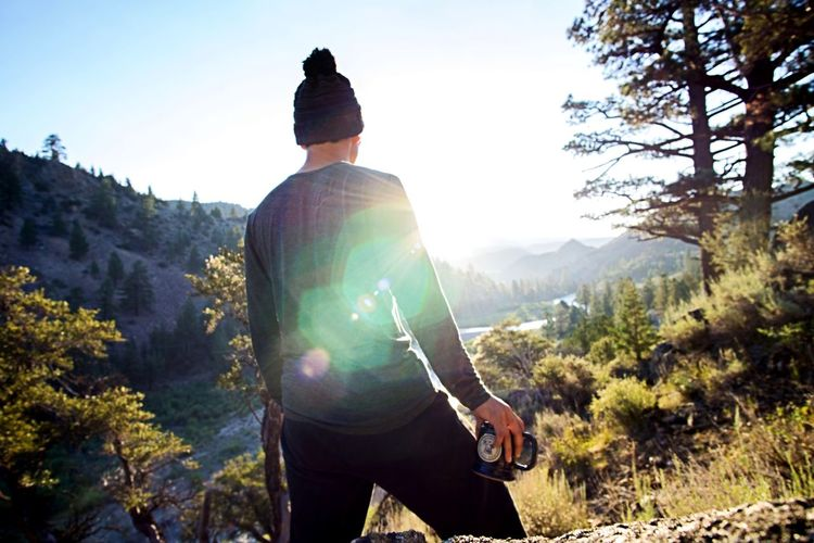 Mountain peak mornings Peaceful Coffee Sunrise Rear View Mountain Sunlight One Person Adventure Real People Outdoors Leisure Activity Nature Landscape Tree