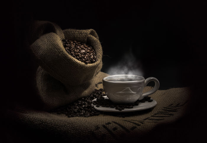 Hot and steamy Black Background Coffee Photography By Julia Martin Steam Caffine Coffee Beans Coffee Cup And Saucer Food Photography Jute Low Light Photography Sackcloth Space Studio Photography