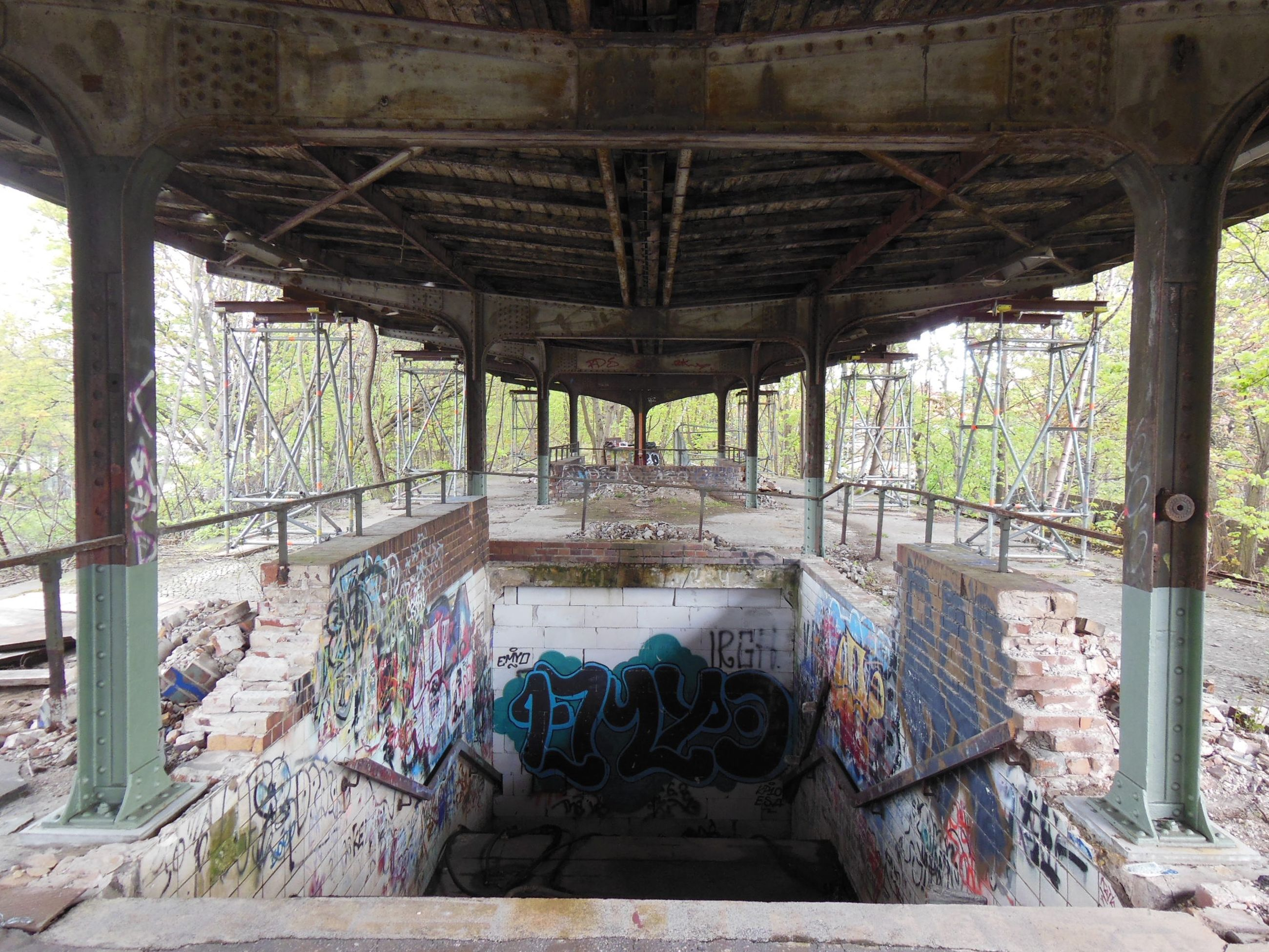graffiti, built structure, architecture, bridge, bridge - man made structure, connection, day, no people, transportation, architectural column, indoors, below, abandoned, mode of transportation, nature, obsolete, run-down, metal, street art, messy, ceiling