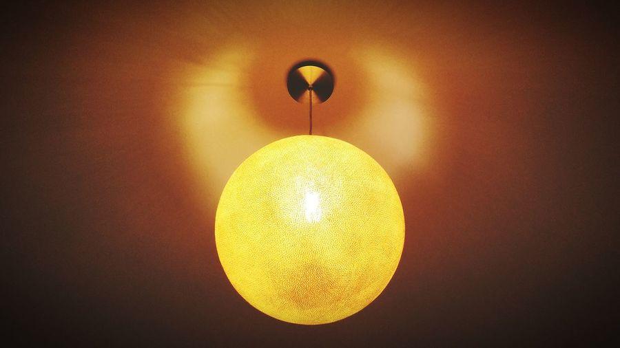 Close-up of illuminated lamp hanging on ceiling
