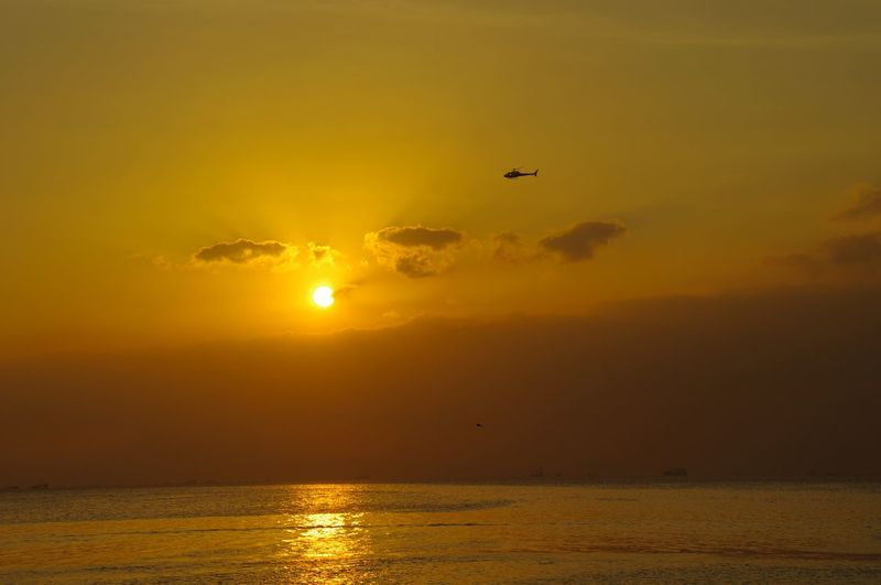 Flying Sunset Travel Outdoors Air Vehicle Mid-air Transportation Landscape Sky Travel Destinations Airplane Scenics No People Beauty Nature Water Kulotitay Clicks