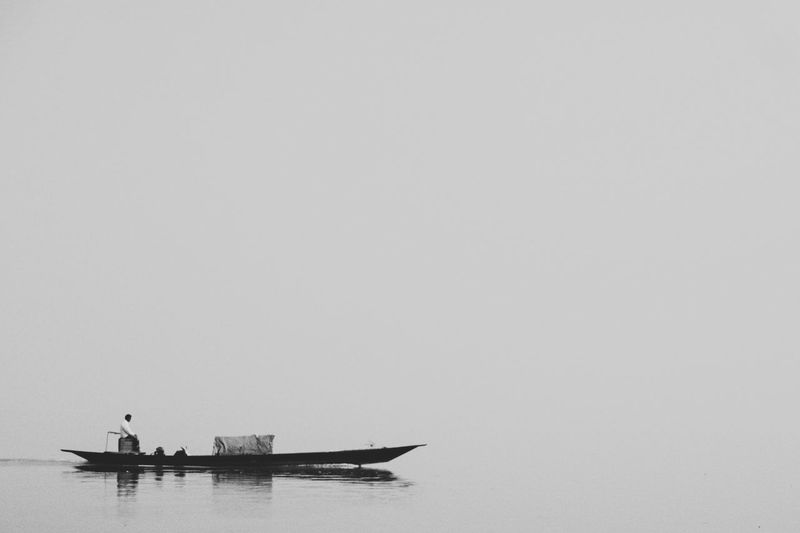 Fisherman Nautical Vessel Mode Of Transport Transportation Outdoors Water People Bangladesh Travel Travel Photography Traveling The World Boat Riverside River View River Collection Waterfront Black And White Black & White Black And White Photography B&w Black And White Collection