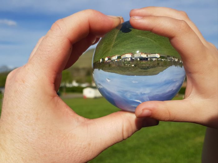 Hands Love Father And Son Parent And Child Holiday Caravan Park Outdoors Memories Childhood Family Quality Time Cloud Camping Playing Inverted Planet Earth Human Hand Holding Environment Close-up Sky Grass Crystal Ball Sphere Globe Crystal