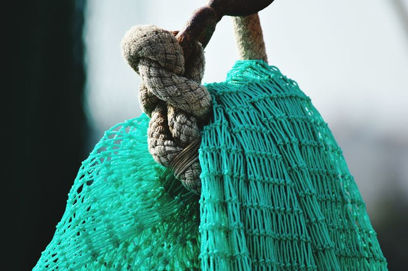 Close-up of net tied up with rope