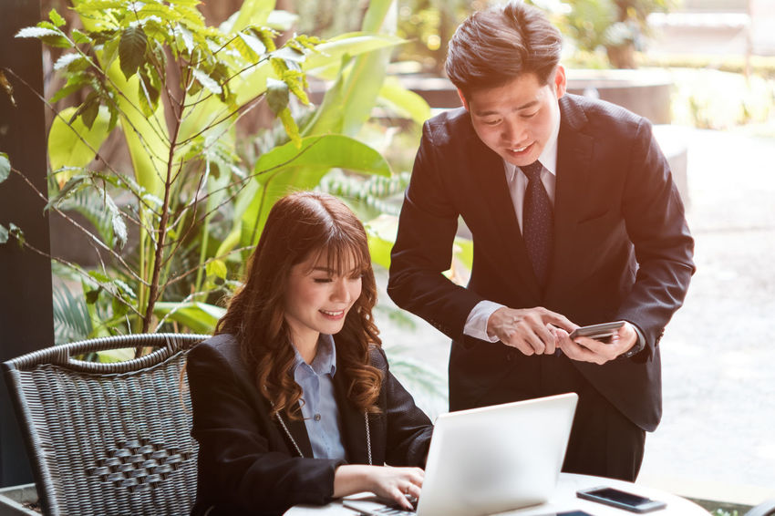 Business Businessman Businesswoman Communication Connection Convenience Cooperation Corporate Business Day Discussion Full Suit Holding Laptop Meeting Men Sitting Suit Teamwork Technology Togetherness Two People Using Laptop Well-dressed Wireless Technology Working