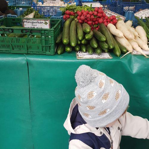 Baby At Market Stall