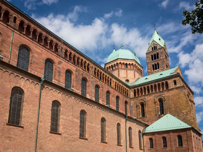 Southern facade of historic Speyer Cathedral, Germany. It is the largest preserved romanesque church and UNESCO world heritage site Building Exterior Built Structure Sky Architecture Cloud - Sky Building Low Angle View Religion Travel Destinations No People Place Of Worship Belief Day History Spirituality The Past Travel City Window Arch Outdoors Spire  Cathedral Romanesque UNESCO World Heritage Site