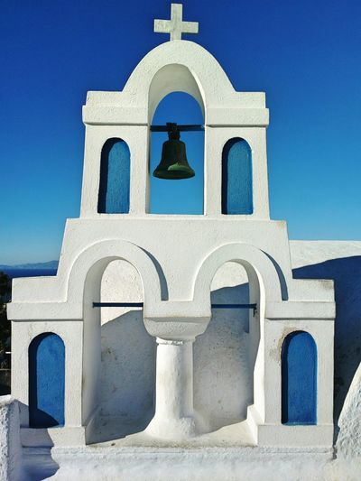 || Street Journals || Santorini, Greece. TheFoneFanatic Nokia  Nokia808 Vacations Mobilephotography PhonePhotography Streetphotography Whitewashed Place Of Worship Blue Religion Cross Arch White Color Sky Architecture Bell #urbanana: The Urban Playground