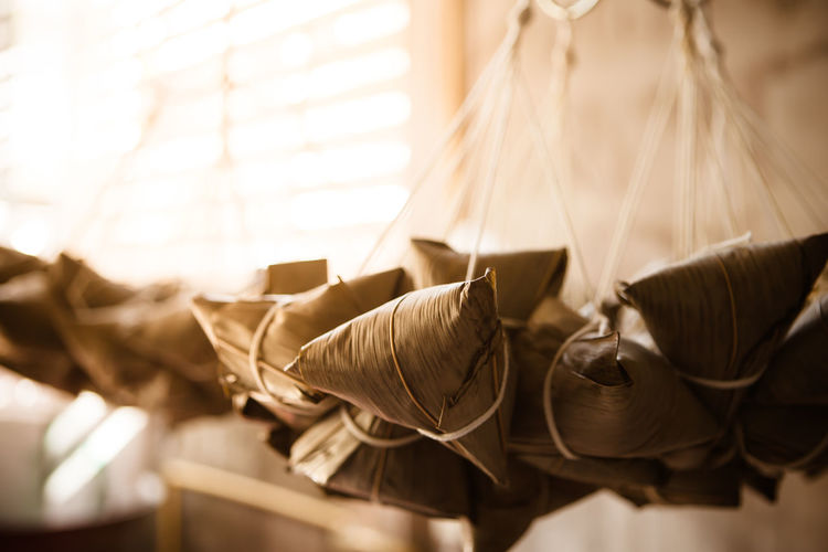 Close-up of clothes hanging on table